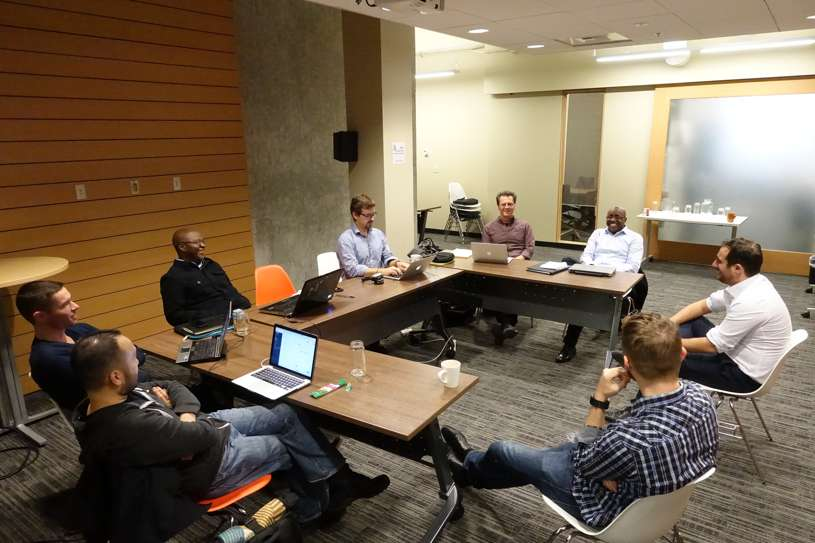 Cohort 1 in discussion with the Capria Accelerator team